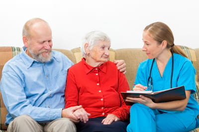 Elderly women and her son at the doctor